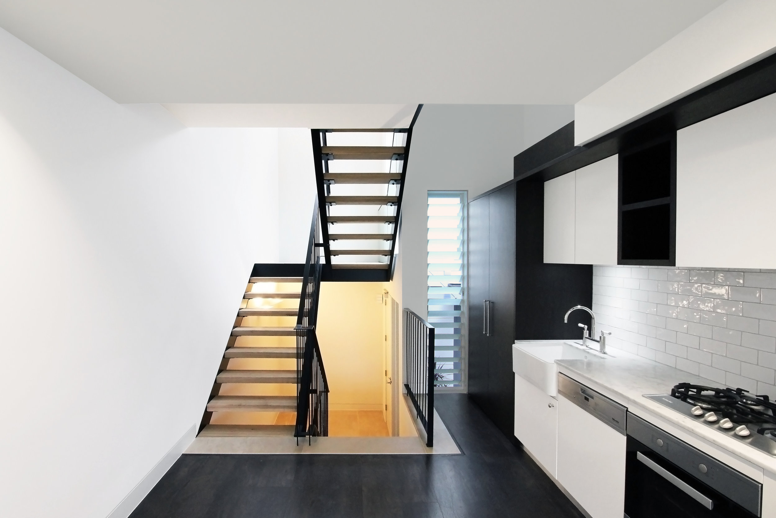 Website | File | Terence Yong Architecture | 3 Townhouses in Balmain : Siblings | House A | Flexible Living-Dining-Kitchen areas and a dramatic open-riser stair beyond.jpg