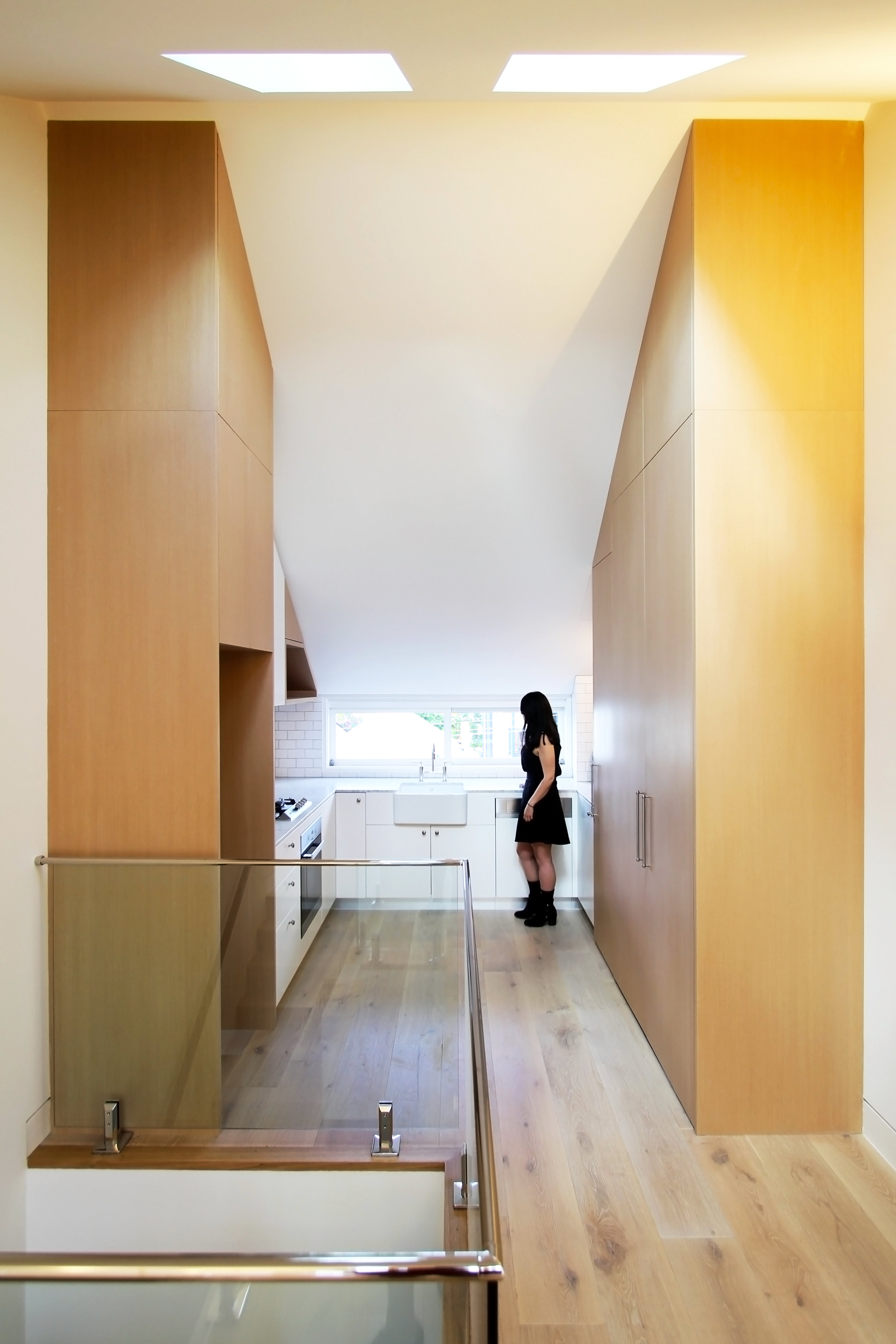 Website | File | Terence Yong Architecture | 3 Townhouses in Balmain : Siblings | House B | A tastefully designed Kitchen with a view across the trees and rooftops towards the city and Anzac Bridge.jpg