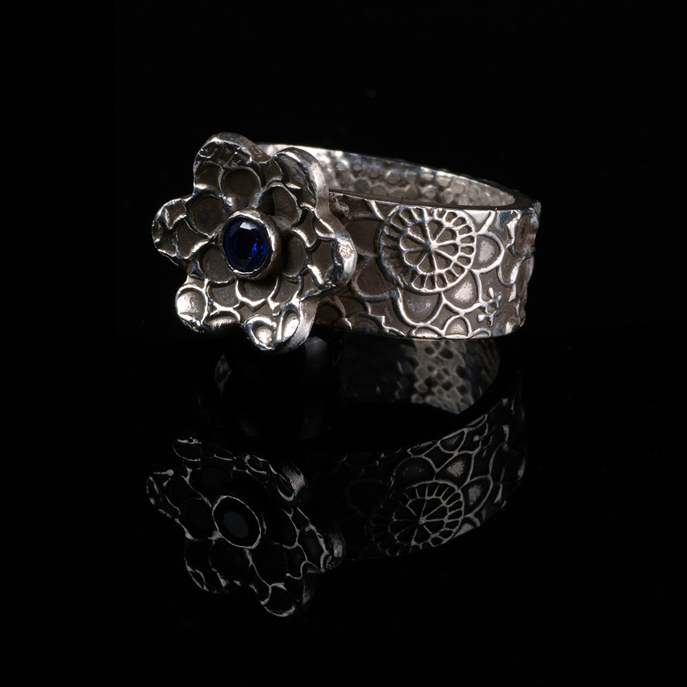 PamHurst-Patterned_Silver_Ring_with_Floral_Motif_and_Sapphire-72-2683.jpg