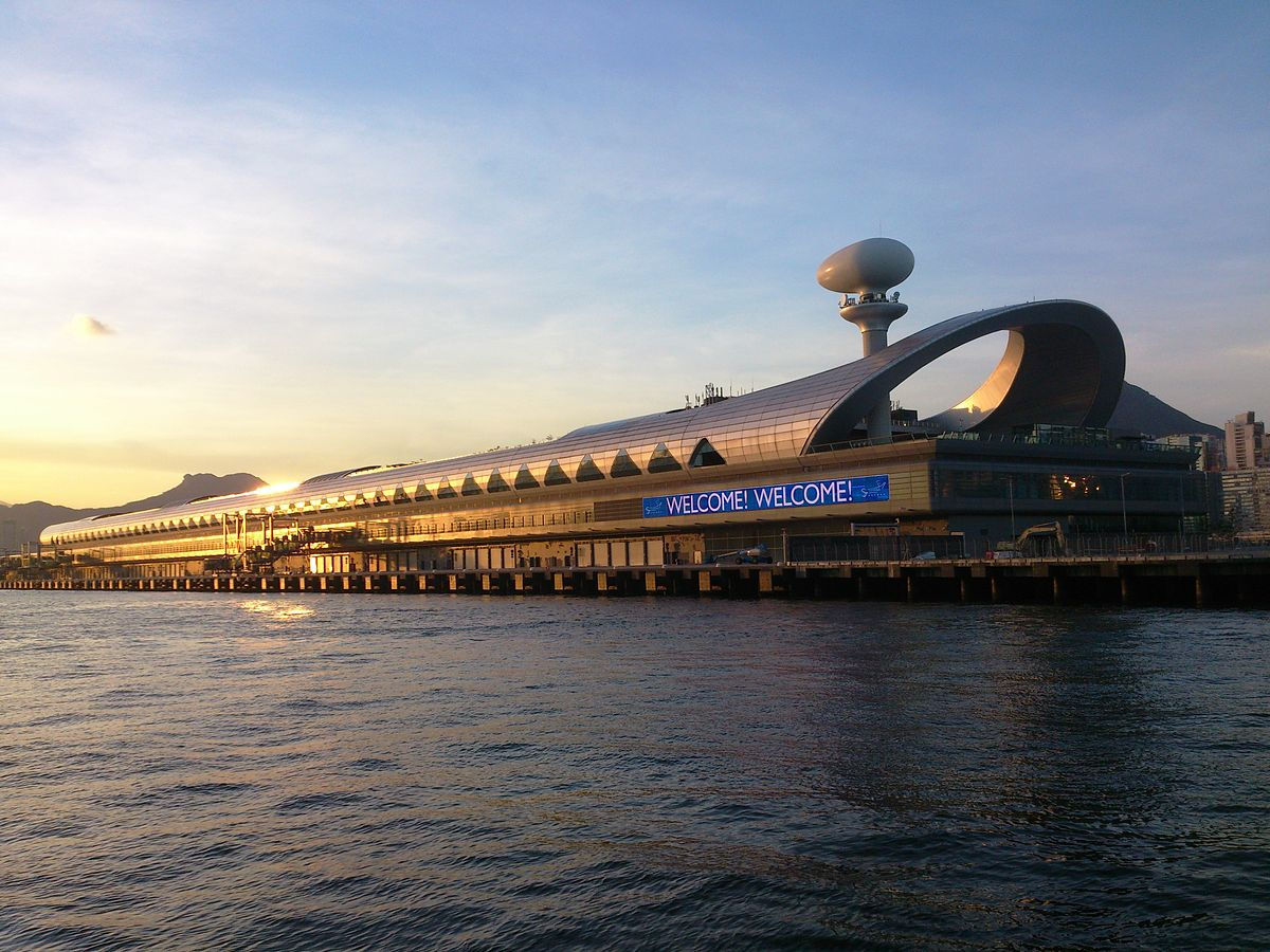 Sunset over Kai Tak Cruise Ship Terminal. Notice Kowloon's famous Lion Rock on the top of the peak seen in the distance.