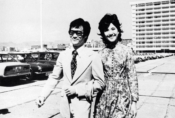 Bruce Lee and Maria Yi on the Roof of Ocean Terminal - My high school graduation watch and first interview suit were purchased here! I wanted a suit like Bruce Lee wore in the opening scenes of Enter the Dragon, as the movie came out the year of my graduation. I remember being shown around by an Englishman who my Dad affectionately referred to as James Bond. He introduced us to beggar's chicken (baked in lotus leaves and mud) in the Spring Deer Restaurant, a Hong Kong classic still open for business!.