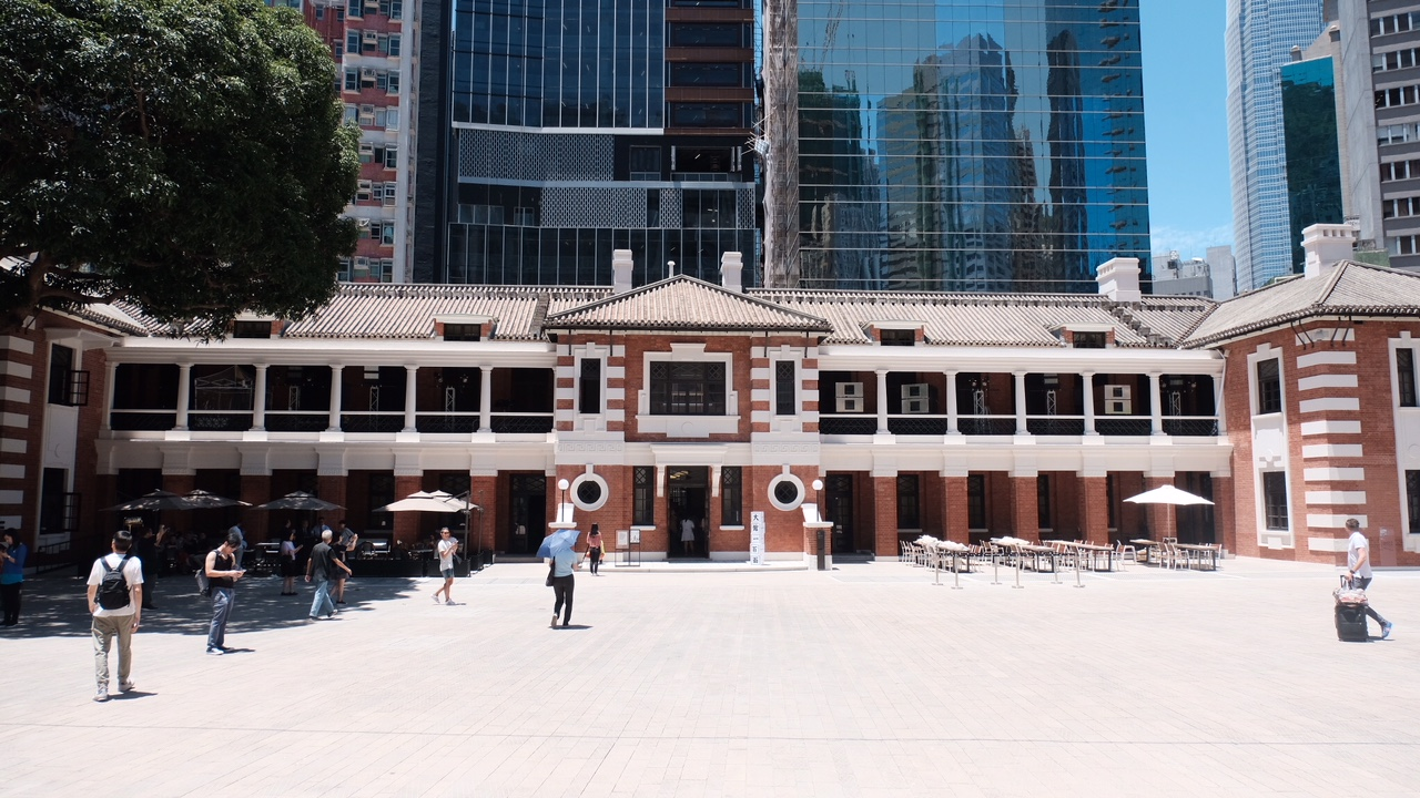 "TAI KWUN  (All Rights Reserved, WilliamBanzai7, 2018)  Tai Kwun (""Big Station""), the Former Central Police Station Compound, was built between 1864 and 1925, comprises 16 historic building grouped under the former Central Police Station, the Former Central Magistracy and the Victoria Prison. Most of the Hong Kong's historic colonial architecture was demolished for development before the British government handed Hong Kong, Kowloon and the New Territories back to China in 1997. After the first building in the Former Central Police Station Compound was built in the 1860s, the site underwent numerous expansions and reconstruction over the next century.  In 2008, the Hong Kong SAR Government partnered with the Hong Kong Jockey Club to conserve the and revitalise the complex. Tai Kwun partially reopened to the public in May 2018.  Tai Kwun once seen by certain elements of the local populace as a symbol of colonial oppression, has been recast as an arts centre. Tai Kwun was built on the edge of Hong Kong Island's fast-growing downtown in the early 1860s. It is where Ho Chi Minh was imprisoned in the 1930s, where the Japanese army established a base during the second world war, where war crimes trials were subsequently held and where the military units that quashed the 1967 riots were stationed. During the course of Colonial Hong Kong's history, many a rogue spent time quartered in Tai Kwun.  I visited Tai Kwun one fine sunny day in May with a few of my guide colleagues, Amy of  Hong Kong Greeters  and Lorena of  Vive Hong Kong Tours . Lorena was kind enough to have arranged entry passes--Thank you Lorena!  It was early days and not everything to be featured in Tai Kwun was yet in full swing. However, my initial impression was that this is truly a world class heritage site revitalization and given the diversity of buildings and space on the site, a great venue for capturing great architectural images and unusual city views. The juxtaposition of law and order with arts is intriguing as well (Old Bailey meets modernism).  I was a bit pressed for time, but managed to capture the following images. I have no doubt that Tai Kwun will wind up high on many Hong Kong visitor bucket lists. Please note that entry is not open and it is necessary to book entry passes online,  here .  To view more of my images of Hong Kong and Macau, please visit my  Flickr Stream  or visit me on Instagram:  @williambanzai7 .   Hope to see you soon on the Streets of Hong Kong or Macau!   WB7  End of Dispatch"