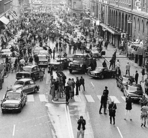 collectivehistory :     September 3rd, 1967, Stockholm, Sweden: The day Sweden changed from driving on the left to driving on the right.     Mayhem.   On Dagen H, Sunday, 3 September, all non-essential traffic was banned from the roads from 01:00 to 06:00. Any vehicles on the roads during that time had to follow special rules. All vehicles had to come to a complete stop at 04:50, then carefully change to the right-hand side of the road and stop again before being allowed to proceed at 05:00. In Stockholm and Malmö, however, the ban was longer—from 10:00 on Saturday until 15:00 on Sunday—to allow work crews to reconfigure intersections. Certain other towns also saw an extended ban, from 15:00 on Saturday until 15:00 on Sunday.   One-way streets presented unique problems. Bus stops had to be constructed on the other side of the street. Intersections had to be reshaped to allow traffic to merge.   Trams in central Stockholm, in Helsingborg and most lines in Malmö were withdrawn and replaced by buses, and over one thousand new buses were purchased with doors on the right-hand side. Some 8,000 older buses were retrofitted to provide doors on both sides, while Gothenburg exported its RHD buses to Pakistan and Kenya. The modification of buses, paid by the state, was the largest cost of the change. In Gothenburg and Norrköping, and in two Stockholm suburbs, tram networks continued to operate.   In order to avoid blinding the oncoming drivers, all Swedish vehicles had to have their original left-hand-traffic head lamps replaced with right-hand units. One of the reasons the Riksdag pushed ahead with Dagen H despite public unpopularity was that most vehicles in Sweden at the time used inexpensive, standardized round headlamps, but the trend towards more expensive model-specific headlamps had begun in Continental Europe and was expected to spread through most other parts of the world. Further delay in changing over from left- to right-hand traffic would have greatly increased the cost burden to vehicle owners.   Source:  Wikipedia