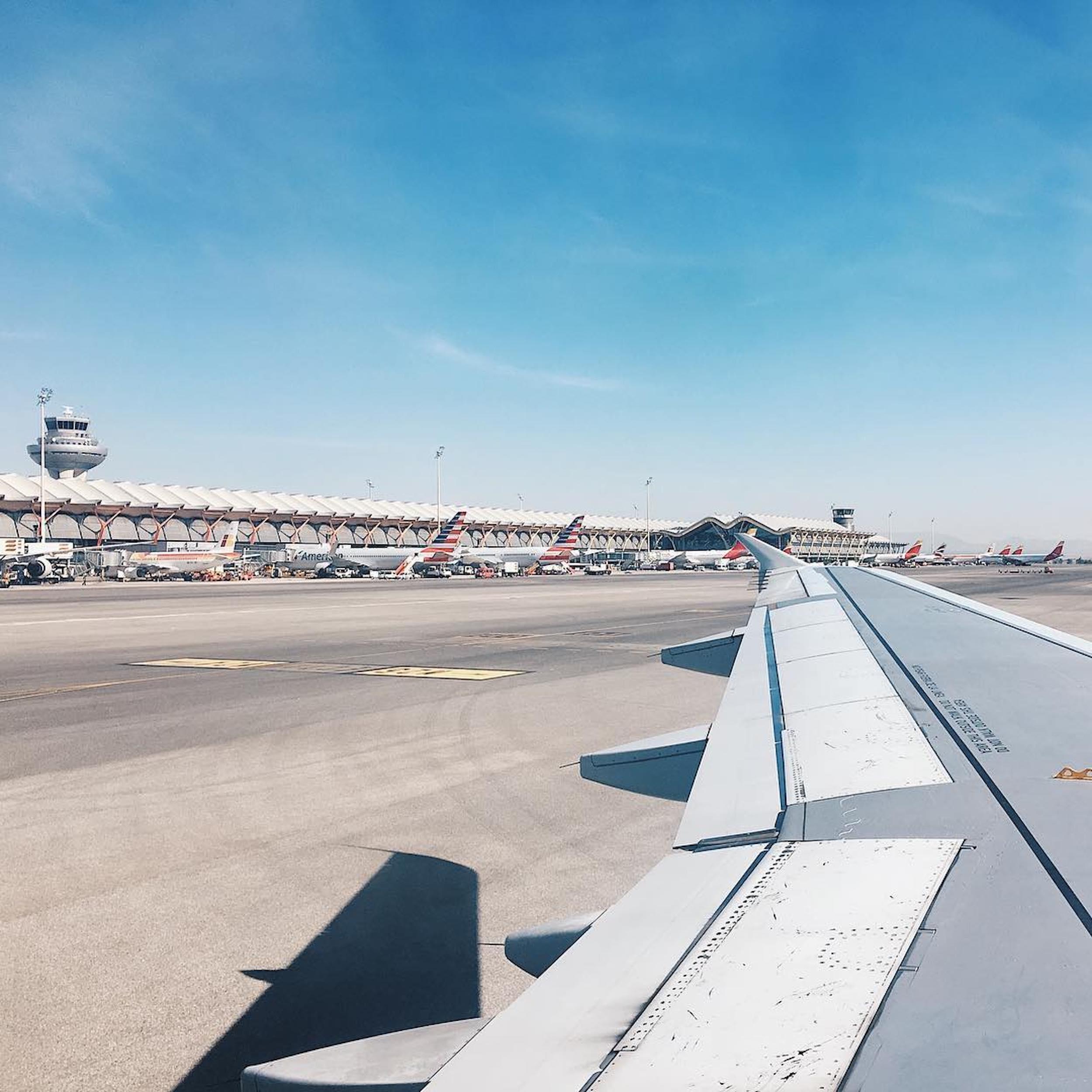 plane-wing-sky-airport.jpg