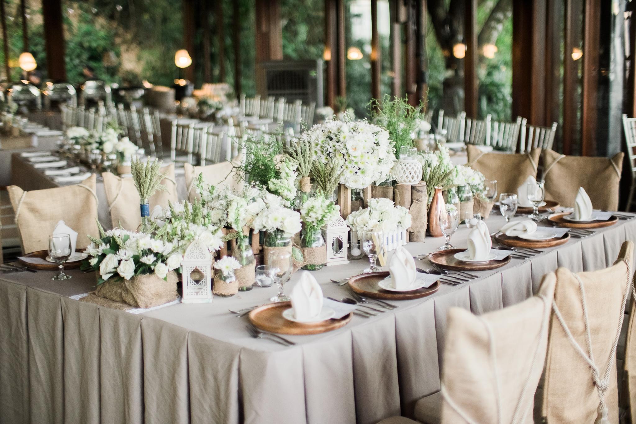 happilyevergara wedding table setting.jpg