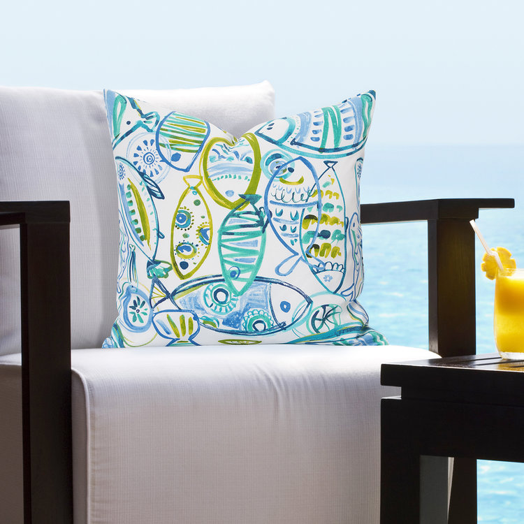Pillows in blues and greens bring the outdoors in.