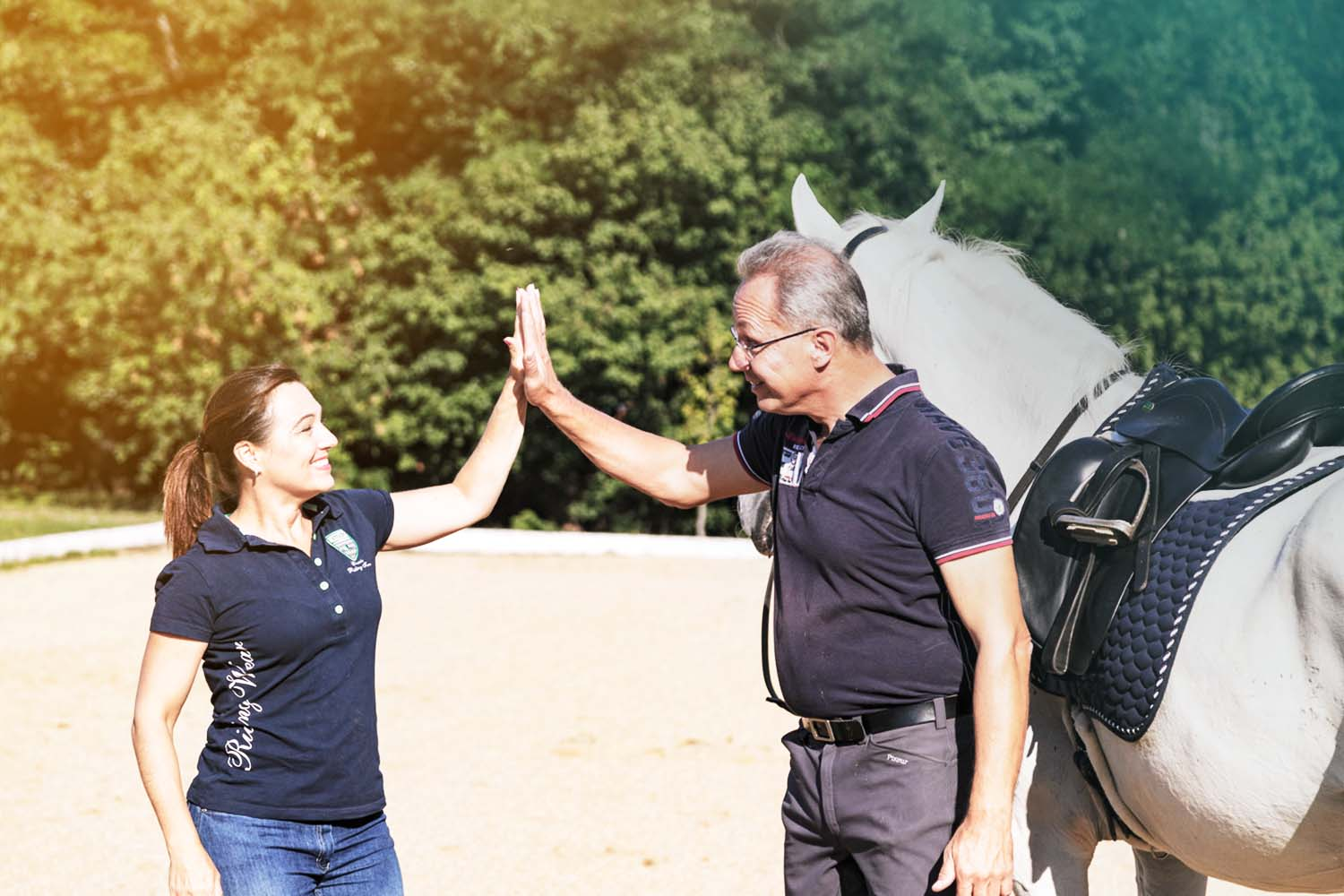 Hello! - I'd like to finally introduce ourselves to you. We are Shana and Thomas Ritter.We live in Germany where we work with riders of all skill levels, all disciplines, and all types of horses. We have taught throughout USA, Canada, Germany, Austria, The Netherlands, and Switzerland. We have published two books on dressage, one based on biomechanics and the other about the work on the longrein. Our next soon-to-be released book is a systematic process to train the Flying Changes.