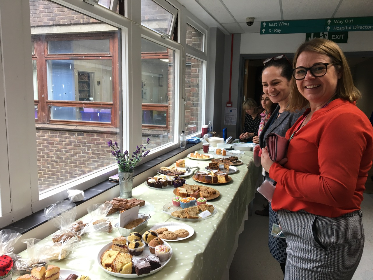 Guests at the Cake Sale for Ovarian Cancer Awareness at the Royal Surrey County Hospital
