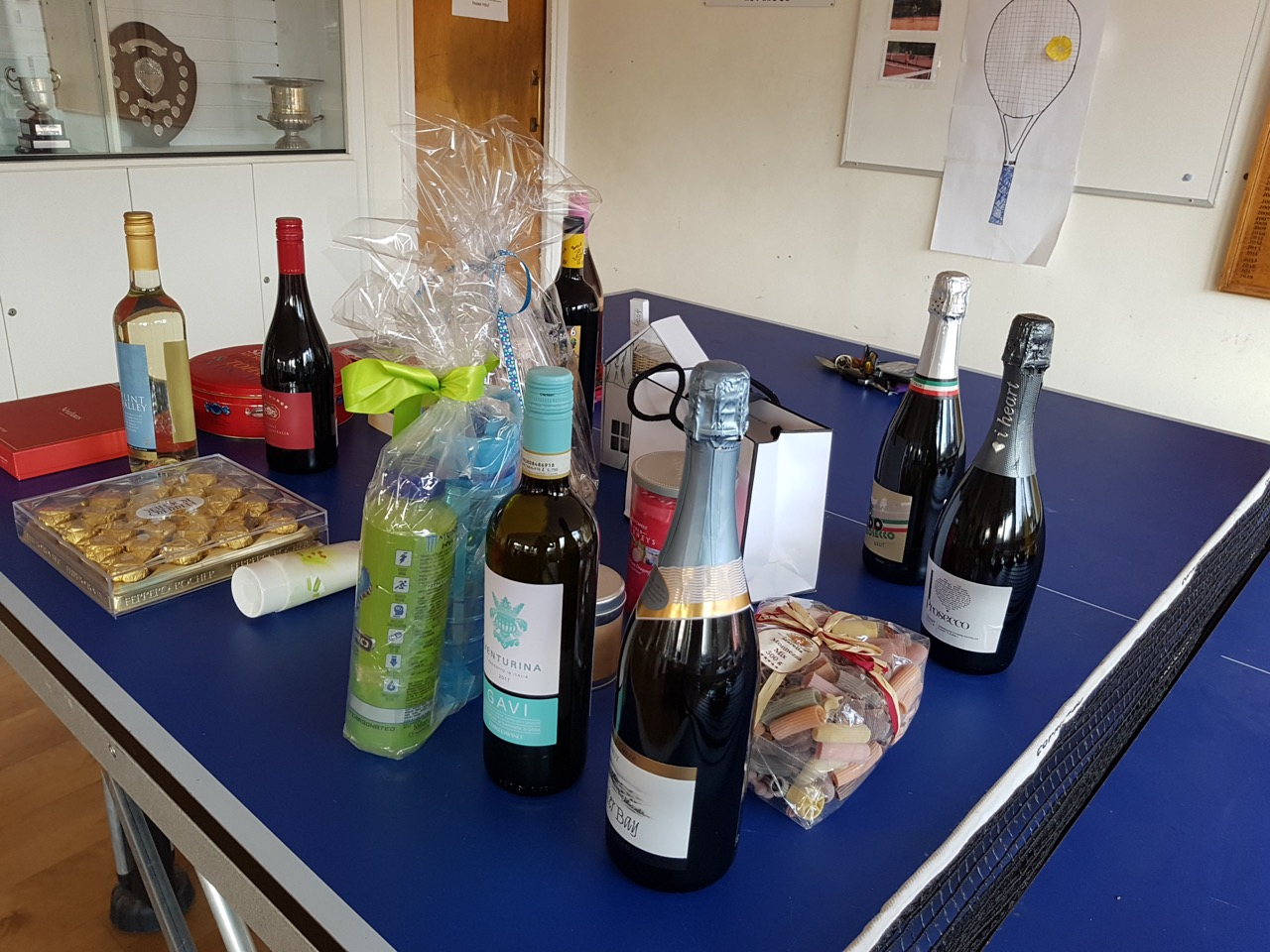Table of raffle prizes at Dorking Tennis Club Winter Tournament fundraising for GRACE
