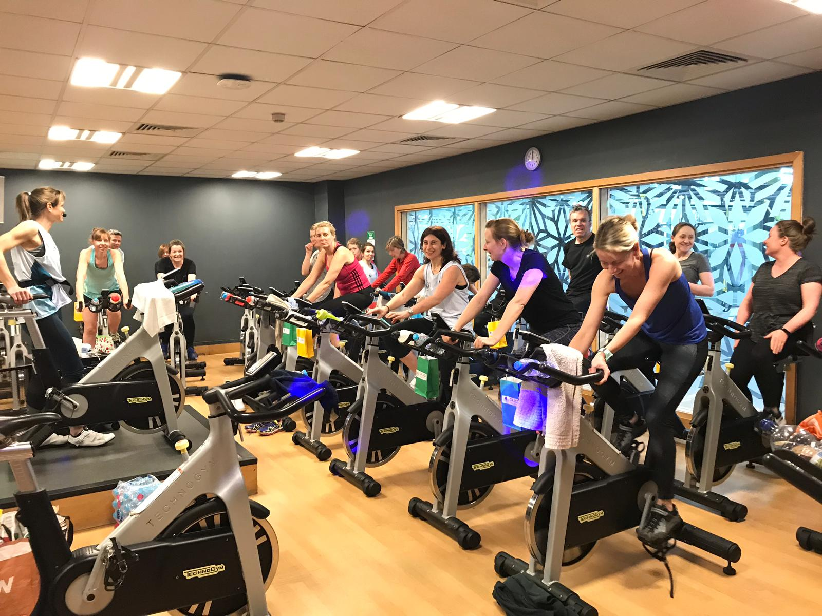 Group taking part in spinning event at Nuffield Health in Sunbury for GRACE