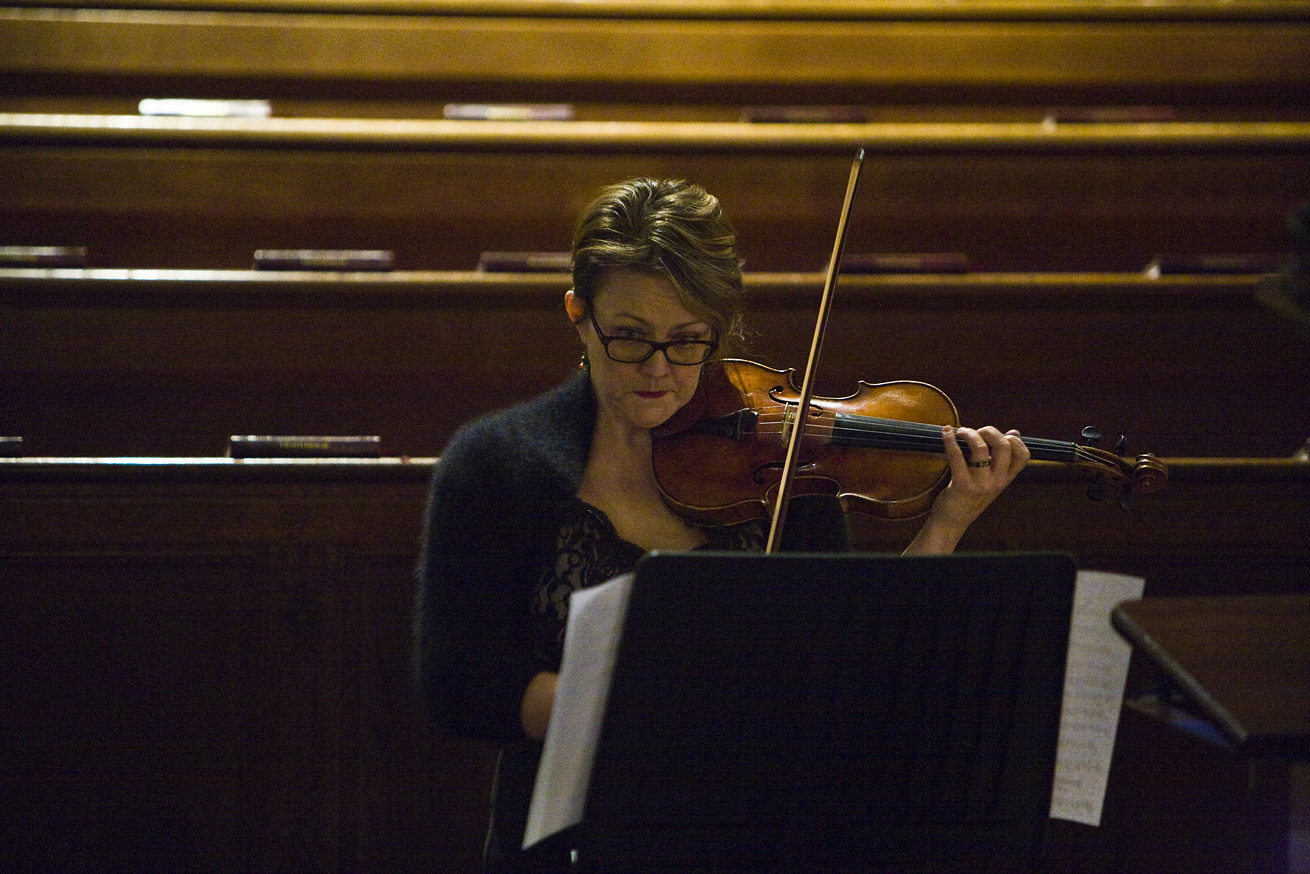 Woman playing violin at Charterhouse Spring Concert for GRACE