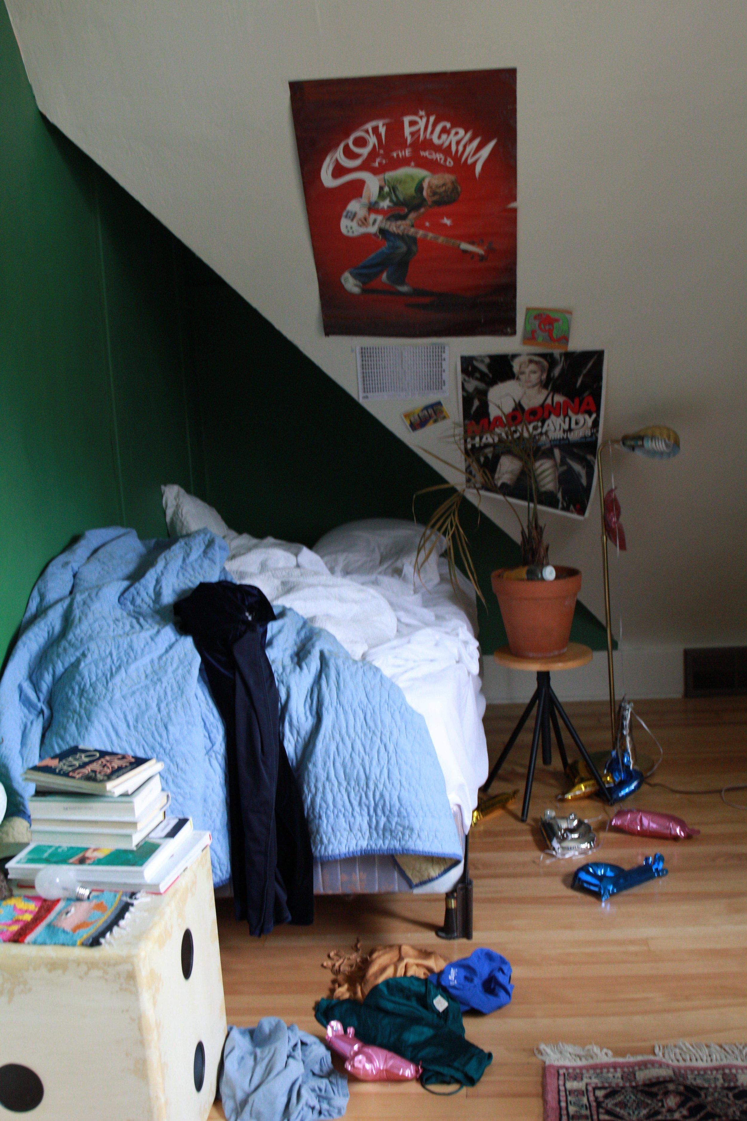 Messy teen bedroom in the 2010s.