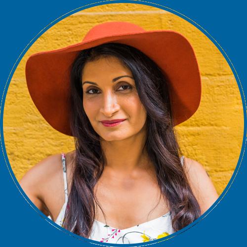 Indu writes bio shot - hat.png