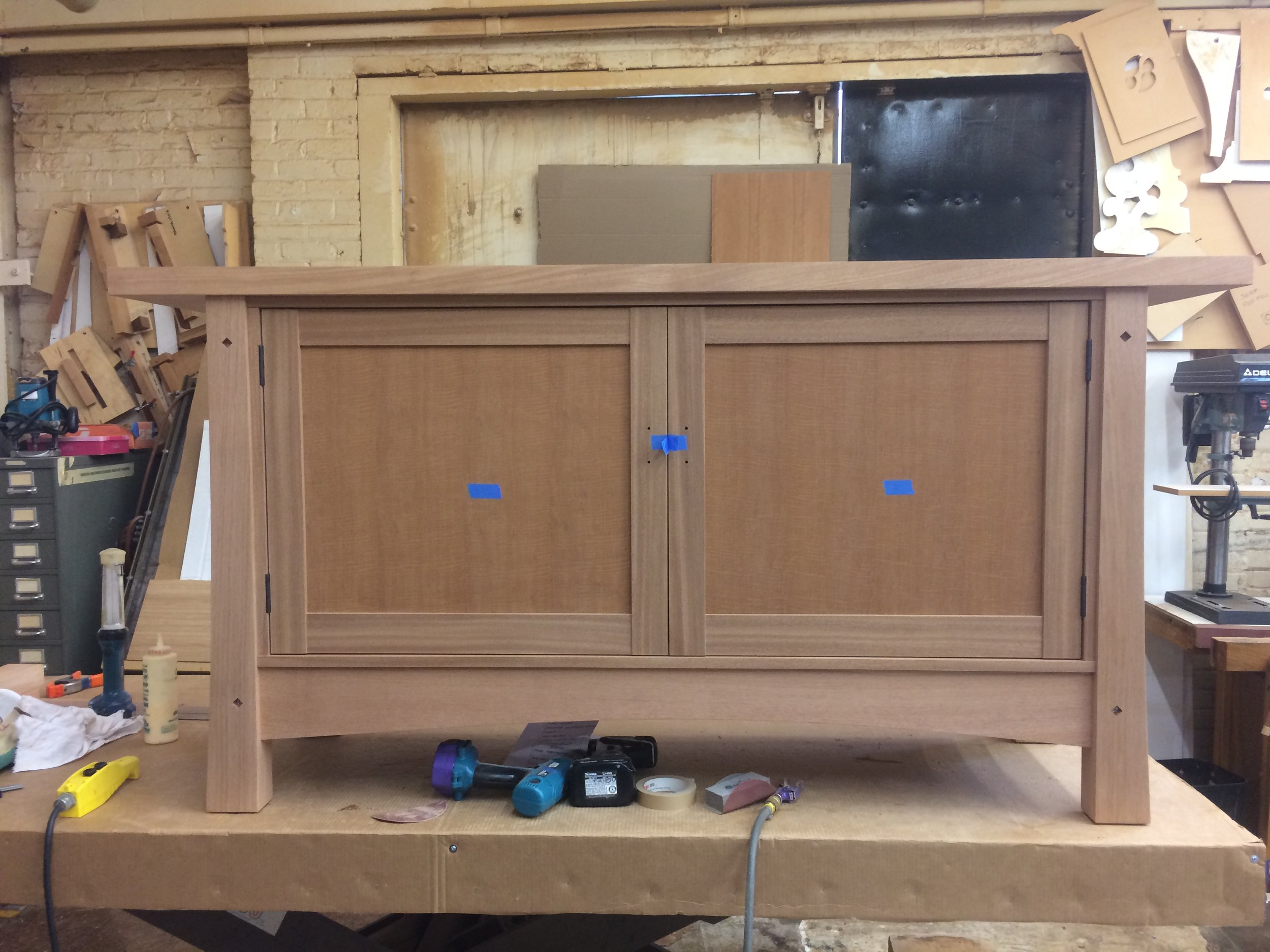 a sideboard under construction, at Berkeley Mills Furniture, my employer from 2012-2019, veneered door panels by yours truly