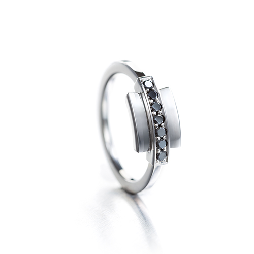 Minimalistic white gold ring is inspired by Art deco. Gold and black diamonds.