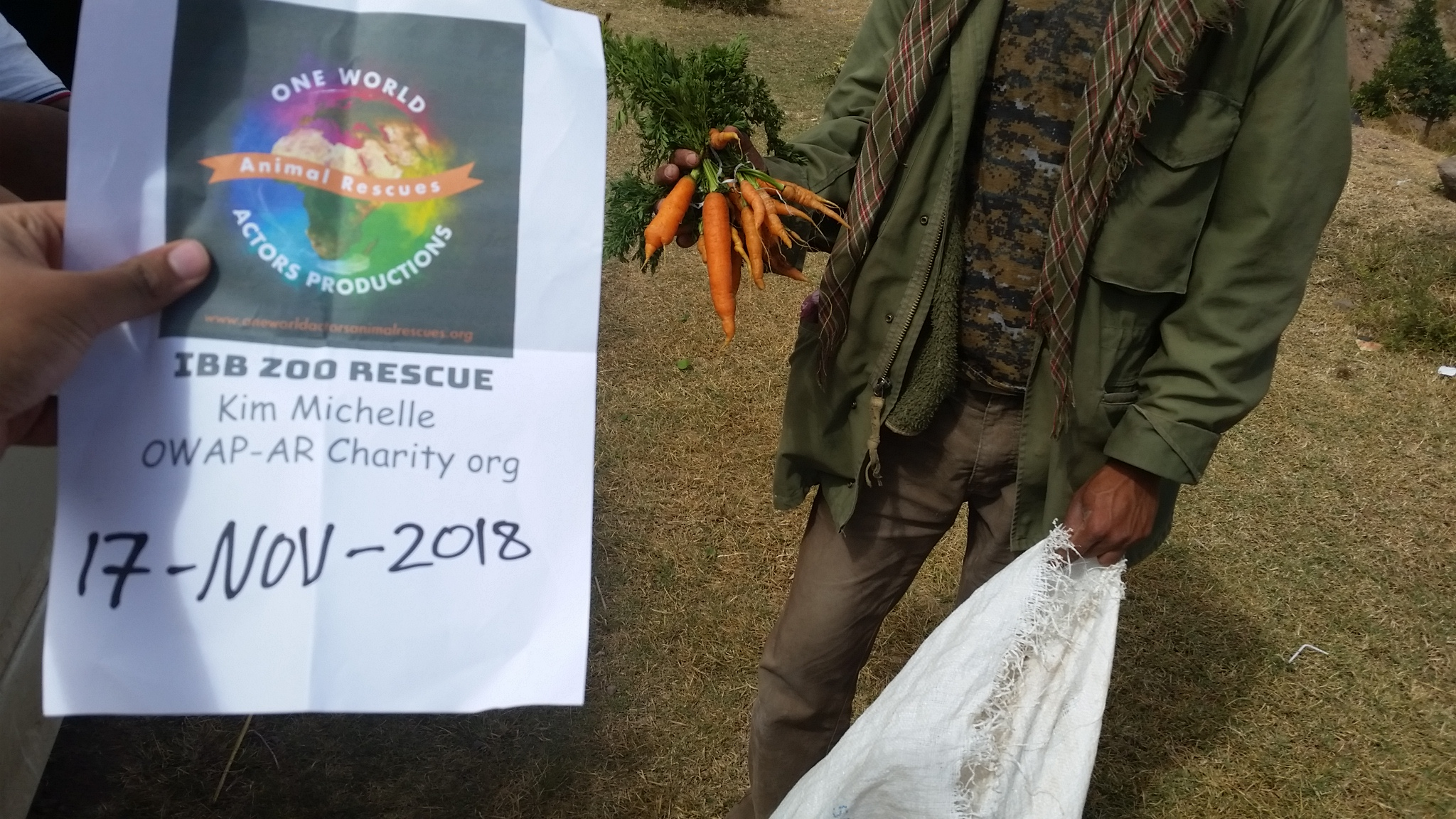 ibb zoo rescue carrots 17 NOV 2018 with our OWAP-AR sign giving horses baboons camels hisham with Abdul razak.jpg