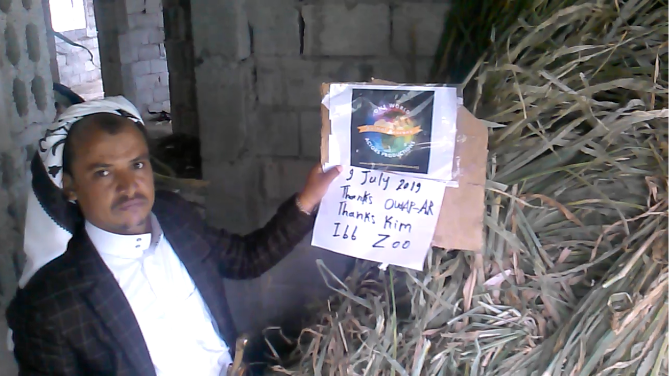 ibb zoo man with OWAP AR sign feed herbivores 9 JULY 2019.png