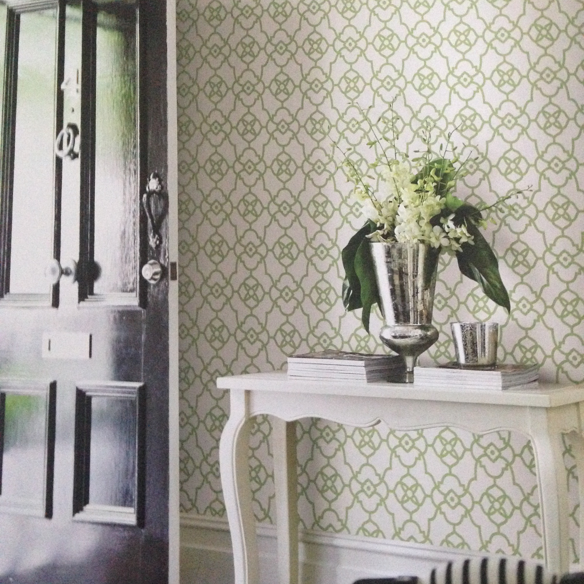 foyer with trellis wallpaper