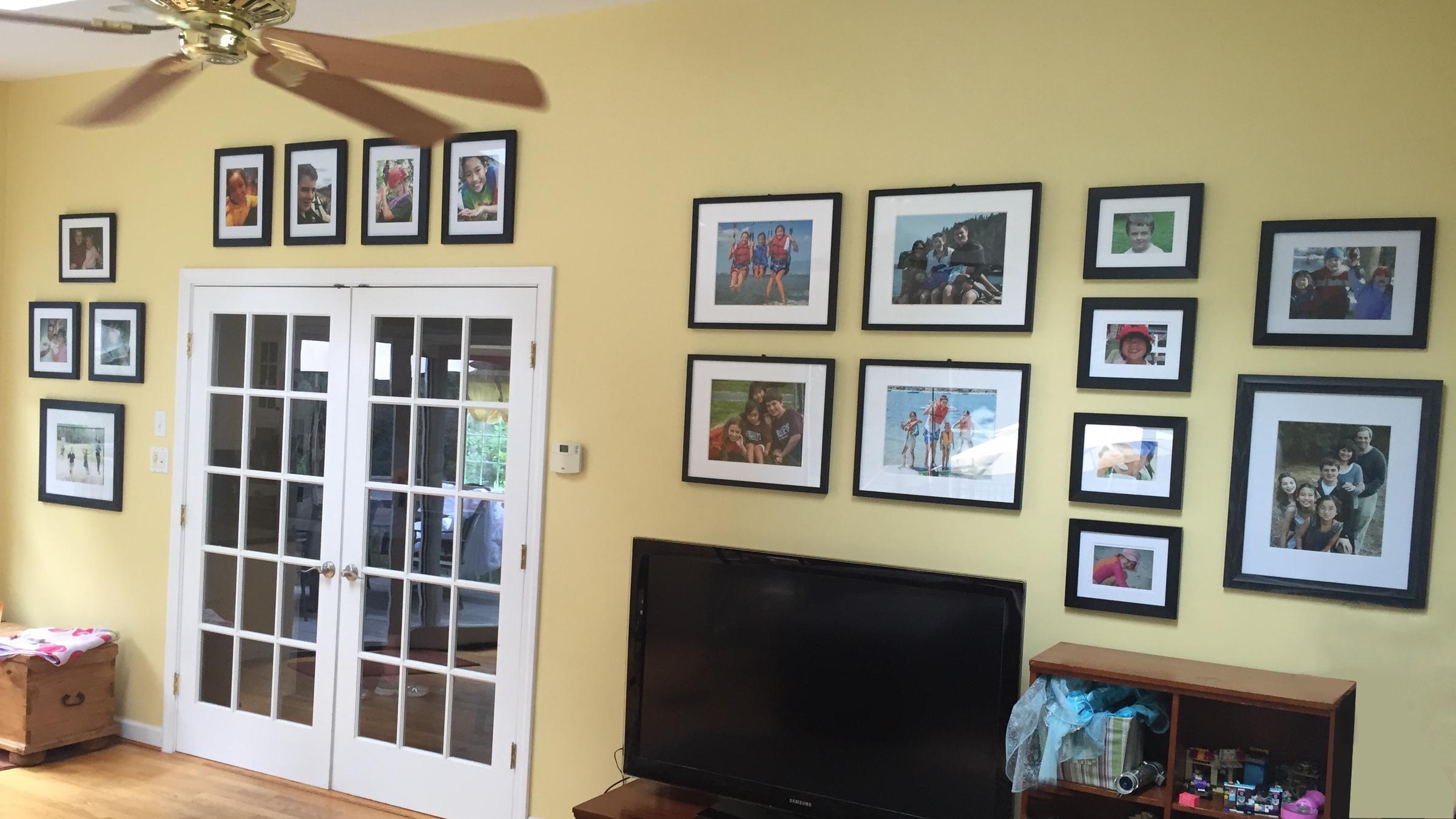 gallery wall around tv and door
