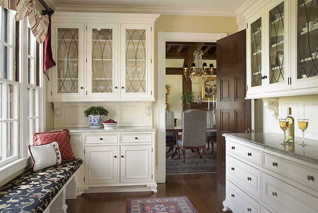 - This creamy white is an enduring classic and remains one of the most popular colors for kitchen and pantry cabinetry.  Here it showcases the elegant lines and furniture detailing against the darker wood floors and warm beige walls of this stunning pantry.