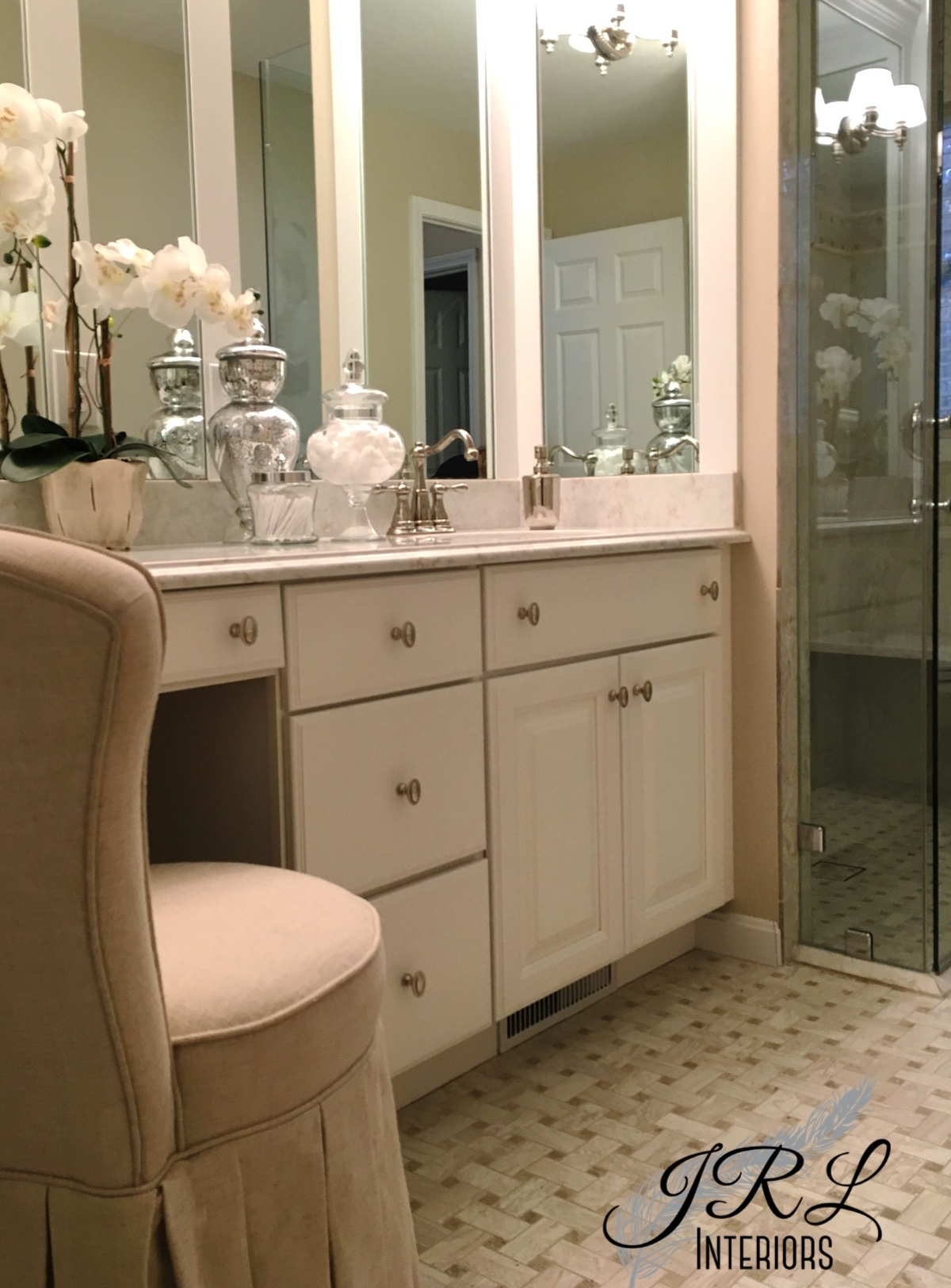 Upholstered linen vanity chair softens the hard surfaces in this Master Bathroom remodel