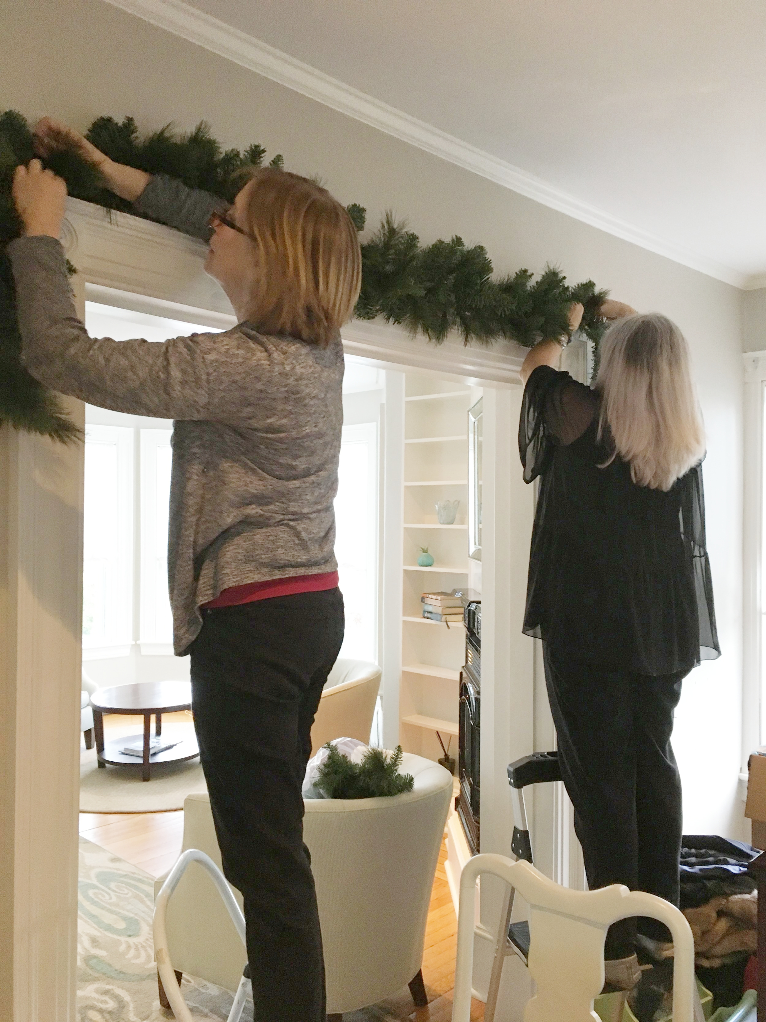 Installing the garland base for the dining room archways