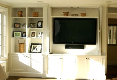 Custom Built-in Media Cabinet with retractable doors by furniture maker Tom Sippel at   Sticks and Stone Studio