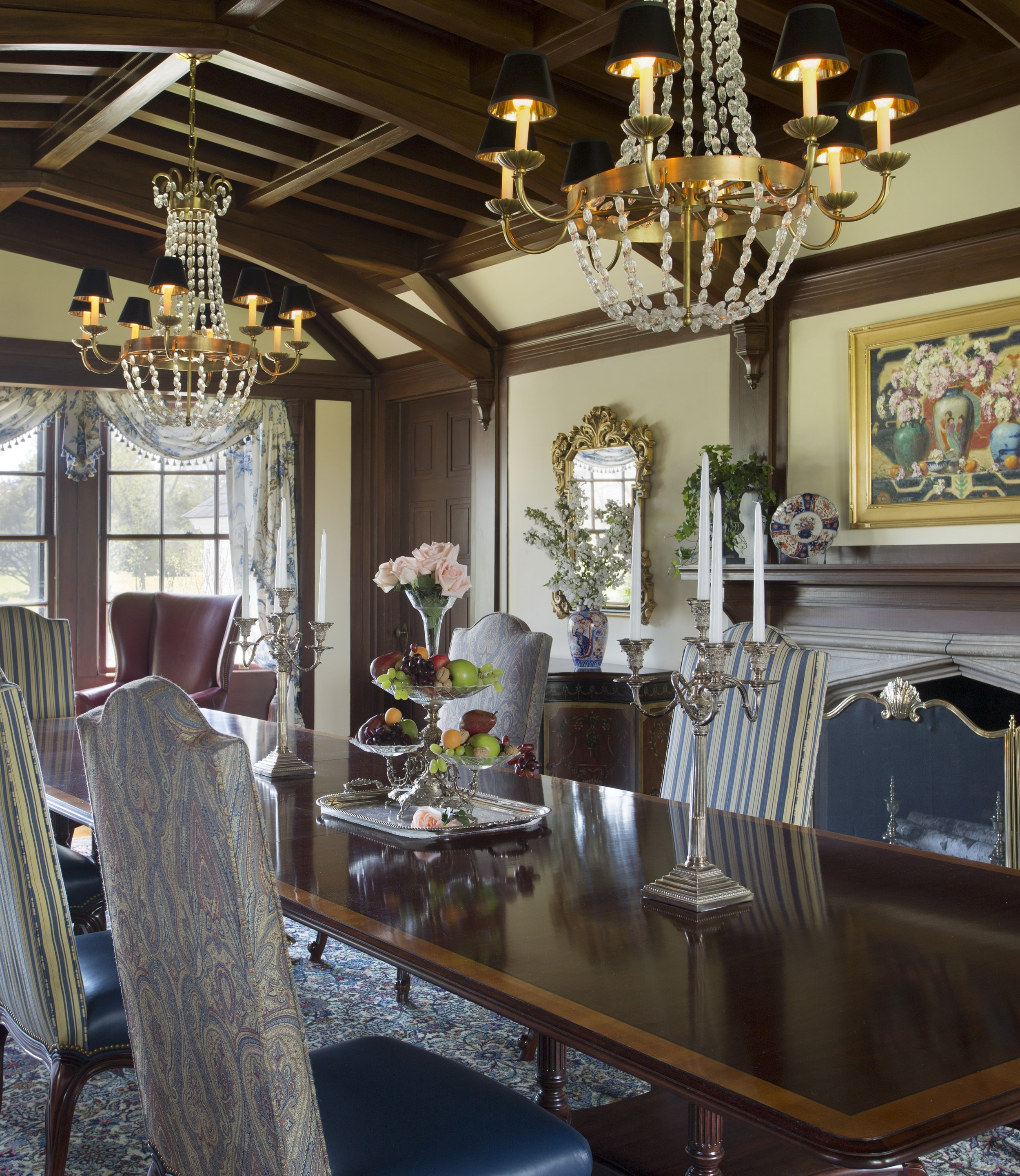 In this grandly scaled dining room, we used two Paris flea market style chandeliers over the table which extends from sixteen to twenty feet. The higher ceiling and overall scale of the room called for hanging them slightly higher.
