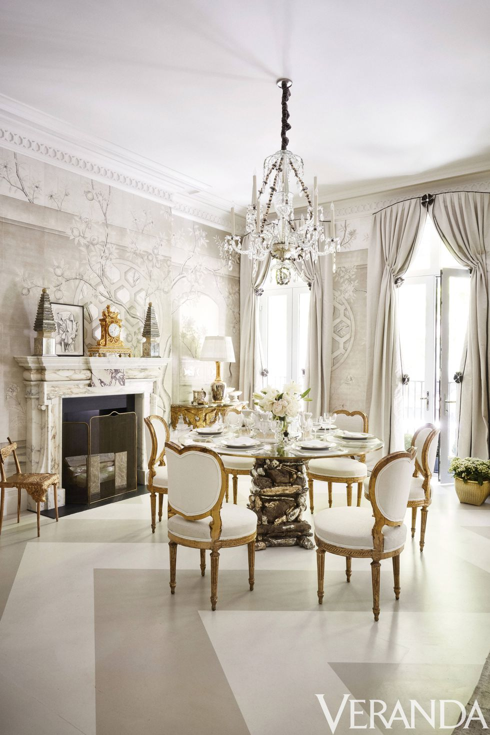 Gorgeous stone mantel in this NY showhouse dining room via   Veranda  . Design by   Alex Papachristidis  . Photo by   Thomas Loof  .