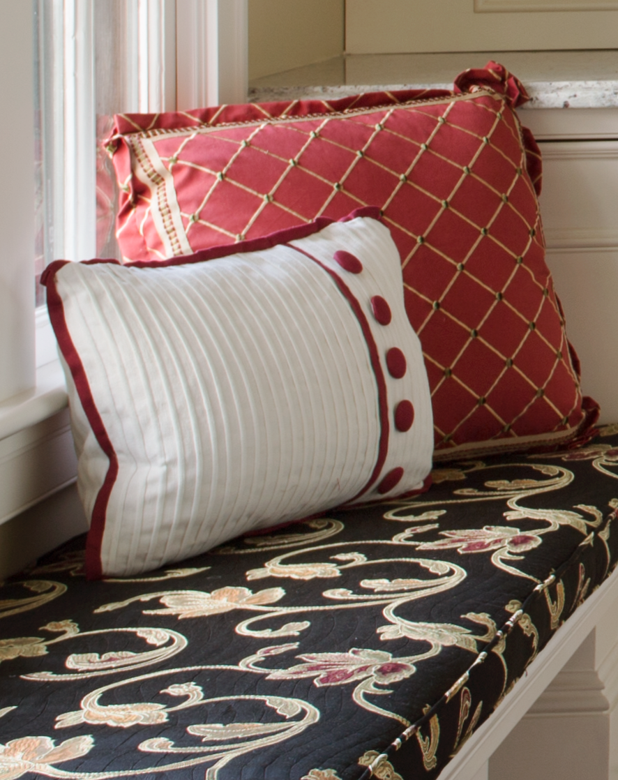 We designed these custom throw pillows with exquisite detailing to add a punch of color to an otherwise neutral room