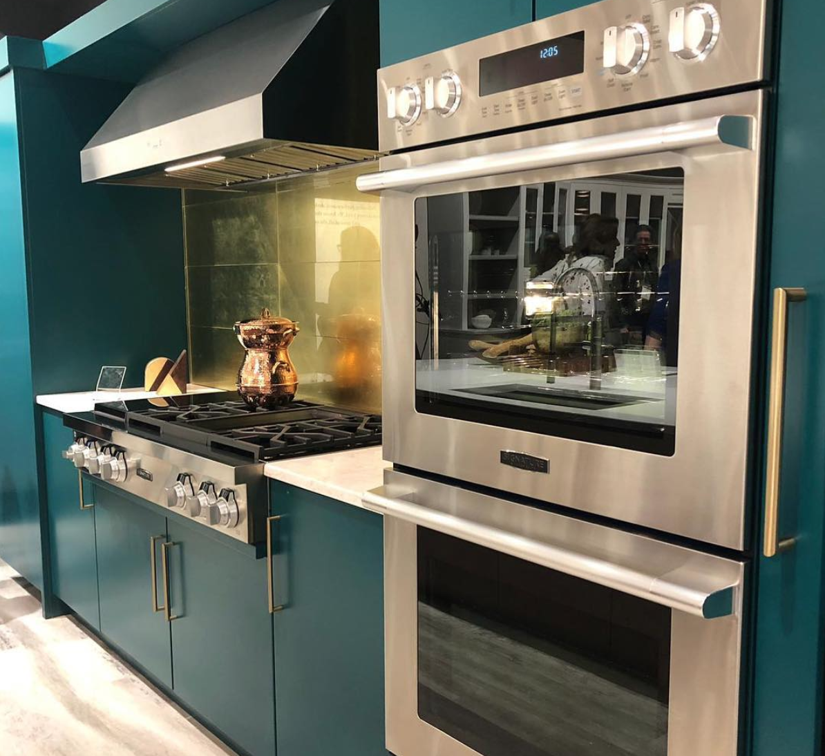 Peacock cabinets at an   SKS Appliance   display at   KBIS