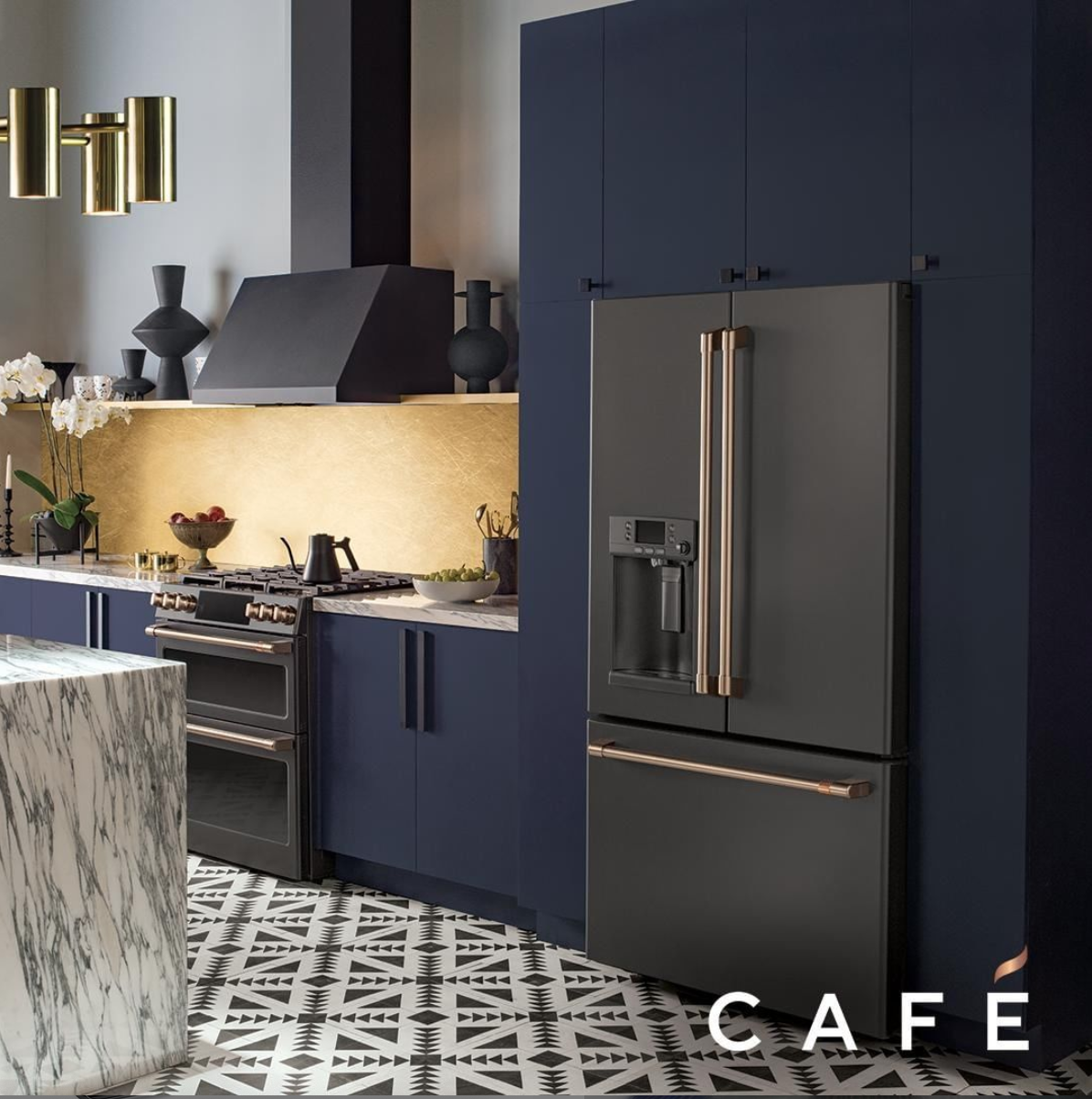 Deep navy cabinets with     Matte black appliances   from   Cafe Appliances   by GE at   KBIS