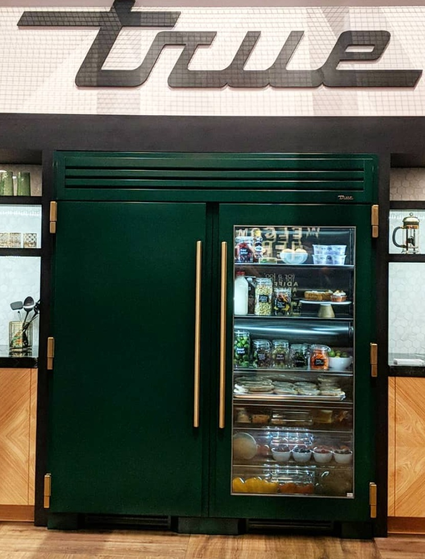 True residential   emerald and brass appliances at   KBIS