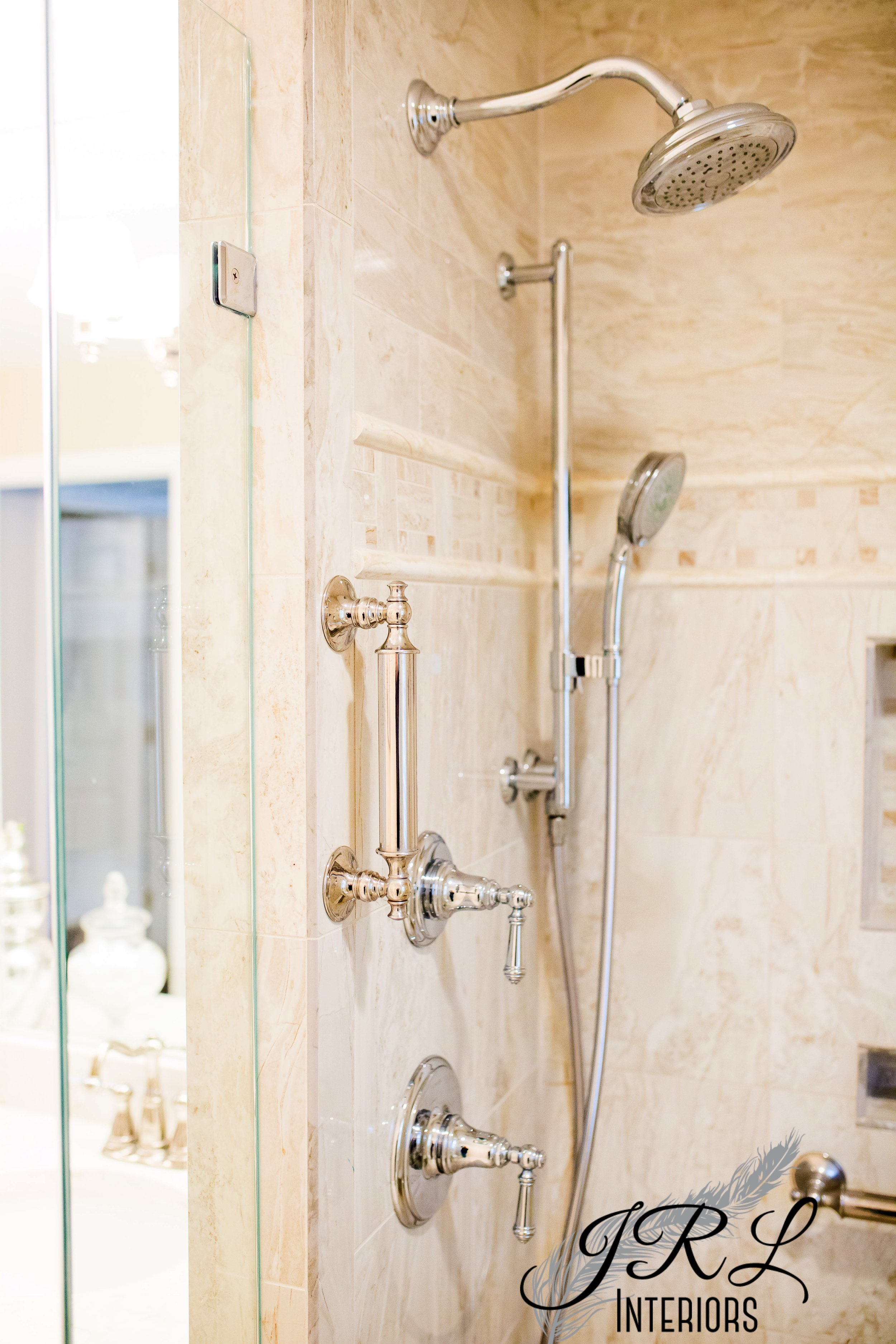 Classic chrome fittings and marble-look porcelain tile keep a timeless look in this master bath renovation