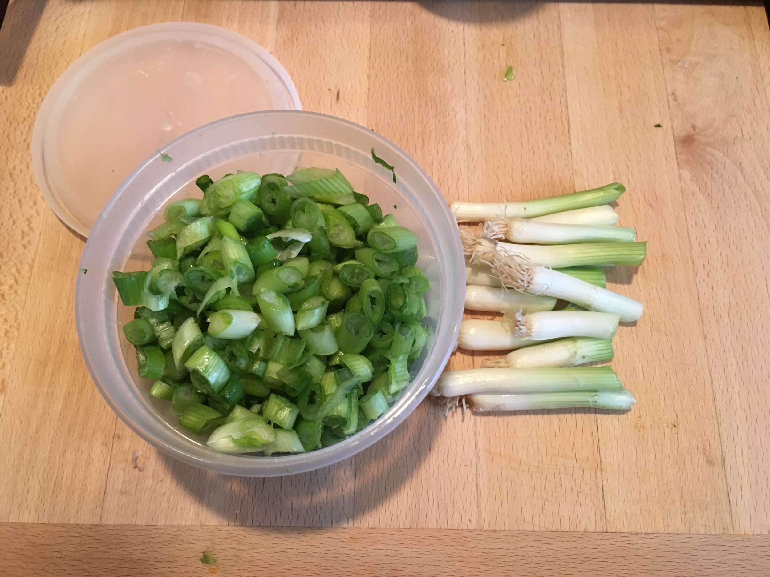 You can even regrow your green onion by putting the white part in a glass with water!