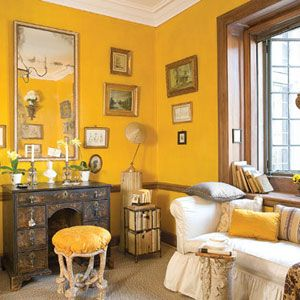"The wall color of the Writing Room by Andrew Virtue at Greystone Estate is inspired by the Nancy Lancaster ""yellow room"".  Image via Veranda"