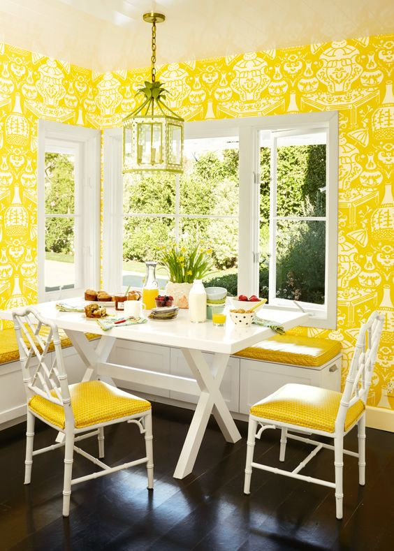 Bright yellow wallpaper enlivens this breakfast room by   Krista Ewart   via   House Beautiful  . Photo by   Douglas Friedman  . White trim and furnishings and dark floors balance the bright yellow.