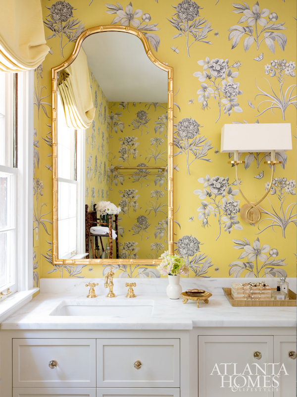 Zoffany wallcovering in this bath by   Melanie Turner   via   Atlanta Homes & Lifestyles  . The yellow wallpaper pairs nicely with the gold accents in the mirror, faucet, lighting, and accessories.