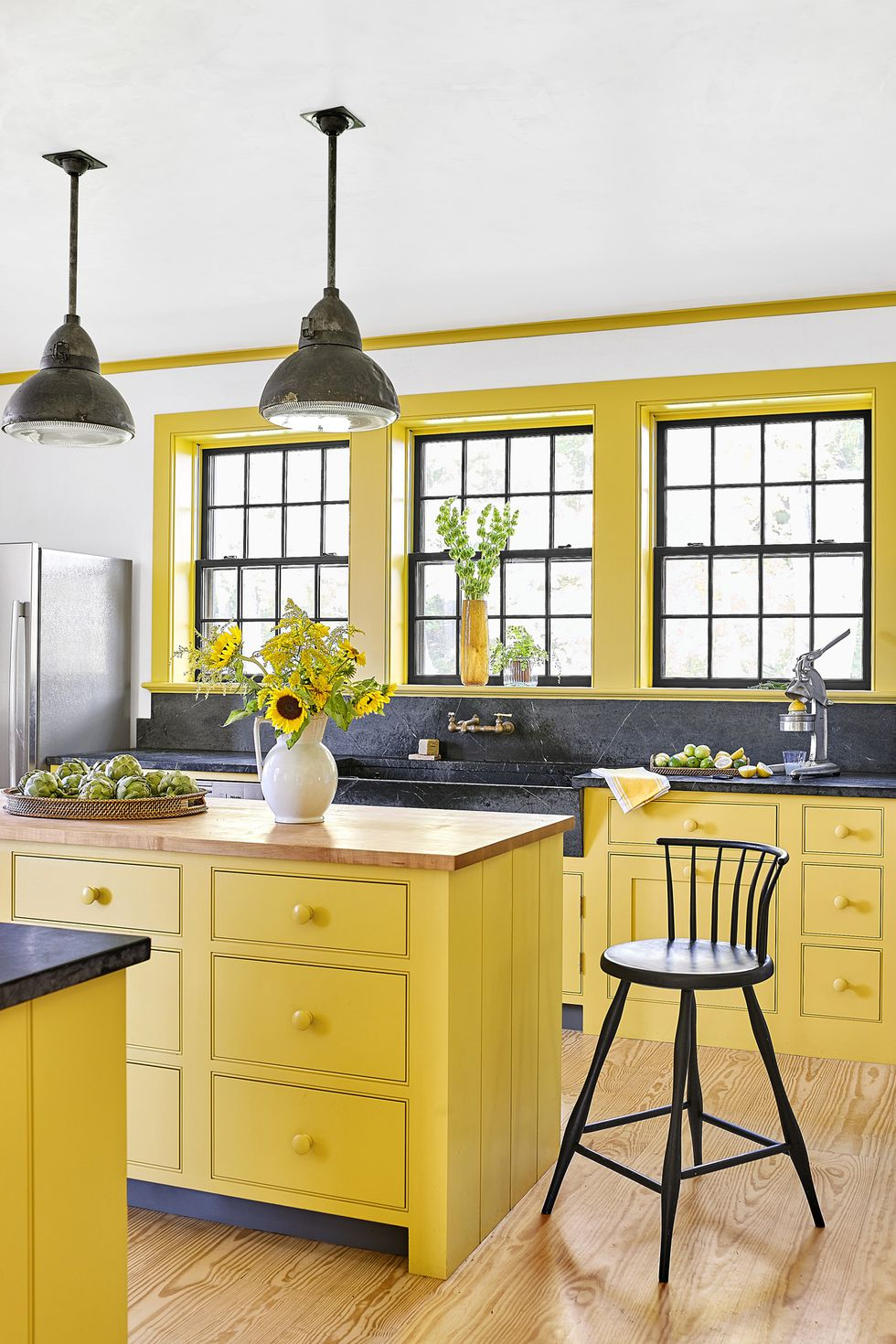 Lemon colored cabinetry in this kitchen by   Rafe Churchill   via   Country Living  ; Paint by Farrow and Ball - color Babouche