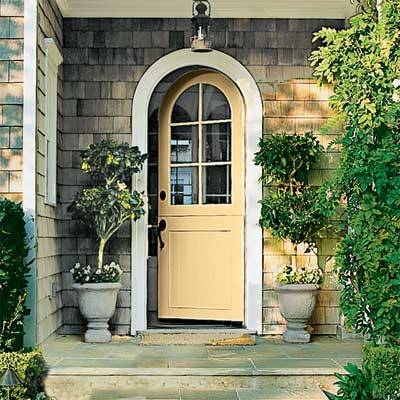 Yellow makes a welcoming door color. Benjamin Moore's Golden Honey is painted on this front door. Image via   This Old House.   Photo by   Dominique Vorillon