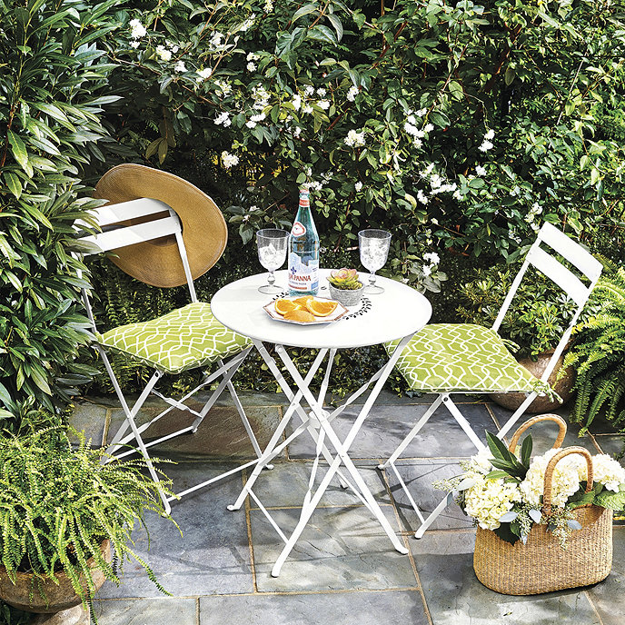 Outdoor dining for two with this charming   French bistro set via Ballard Designs   ,  available in 3 colors