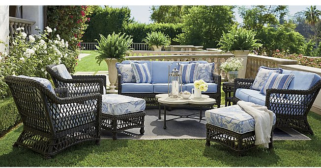 Beautiful all weather resin wicker from   Frontgate   makes a lovely room from which to enjoy the gardens and sip some lemonade. You might want to actually have a patio under that rug…I doubt the lawn will be too happy. Catalog pictures are aspirational but often not realistic! Nonetheless, the furniture is so pretty! I love the combination of floral, solid, stripe and fringe on the various pieces. Outdoor rooms are much the same as indoor rooms when it comes to combining patterns.