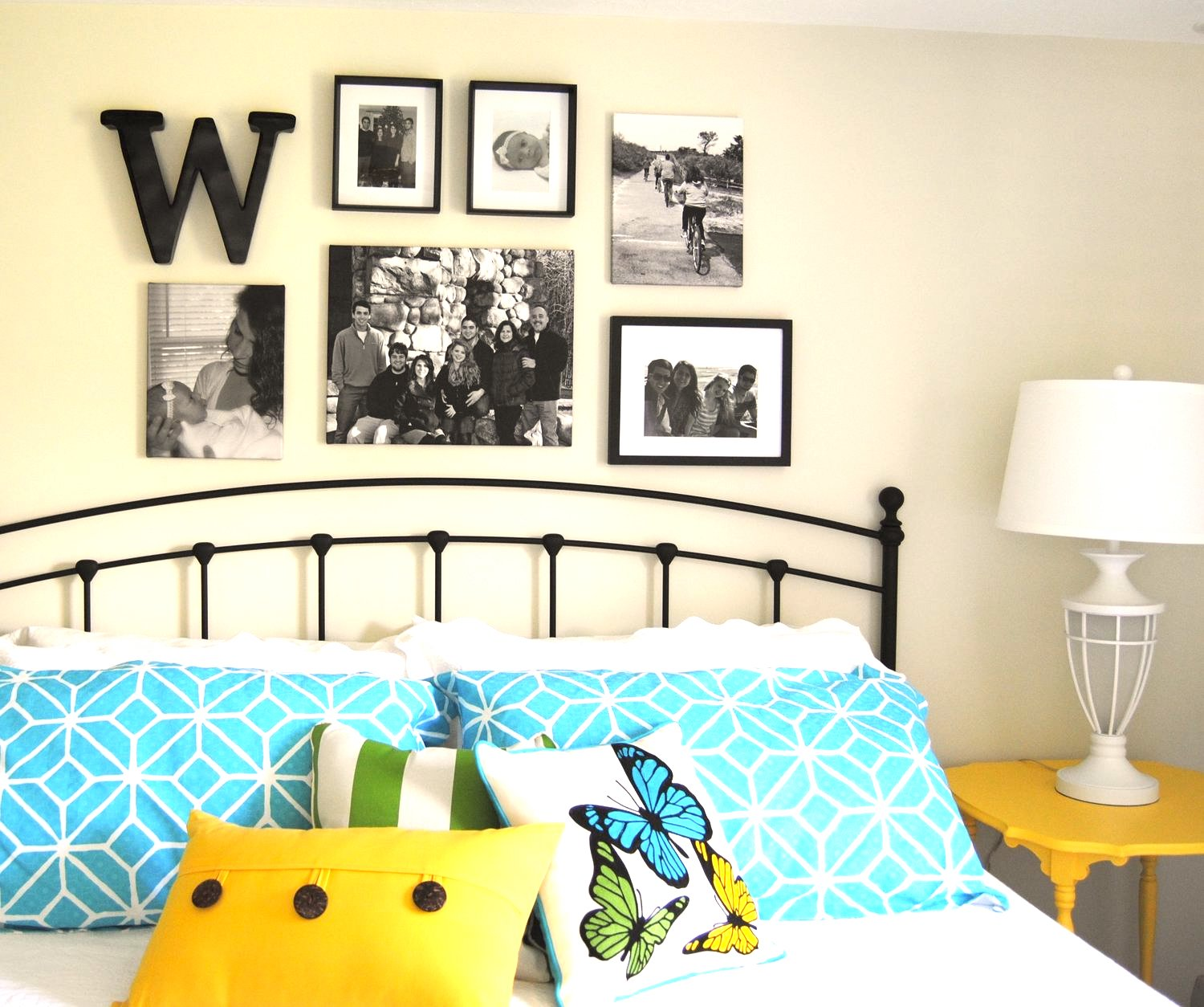 Yellow accent pillows and painted side table in Benjamin Moore yellow highlighter enliven this turquoise guest room