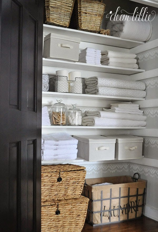 Such a pretty linen closet with charming containers, stenciled walls and neatly folded linens from this closet makeover by Jennifer at Dear Lillie - you can see more about this project on her blog   HERE