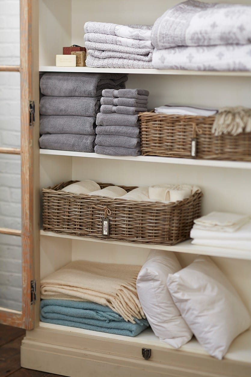Organizing a linen closet at   Ballard Designs