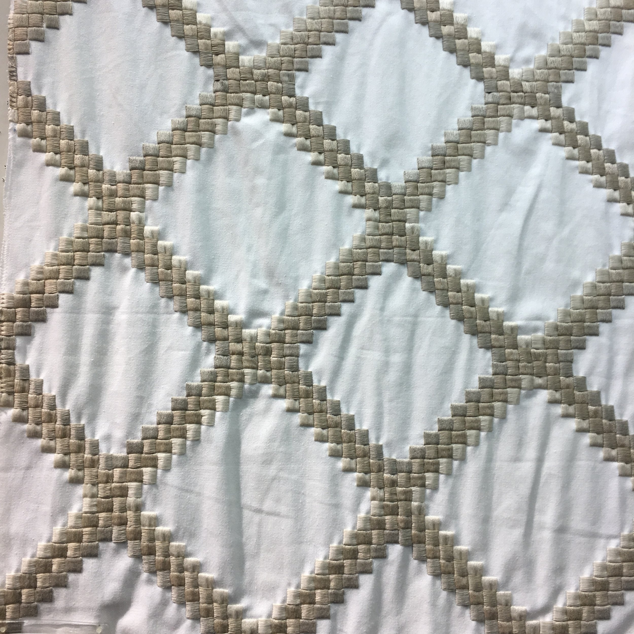 Embroidered trellis fabric at Kravet