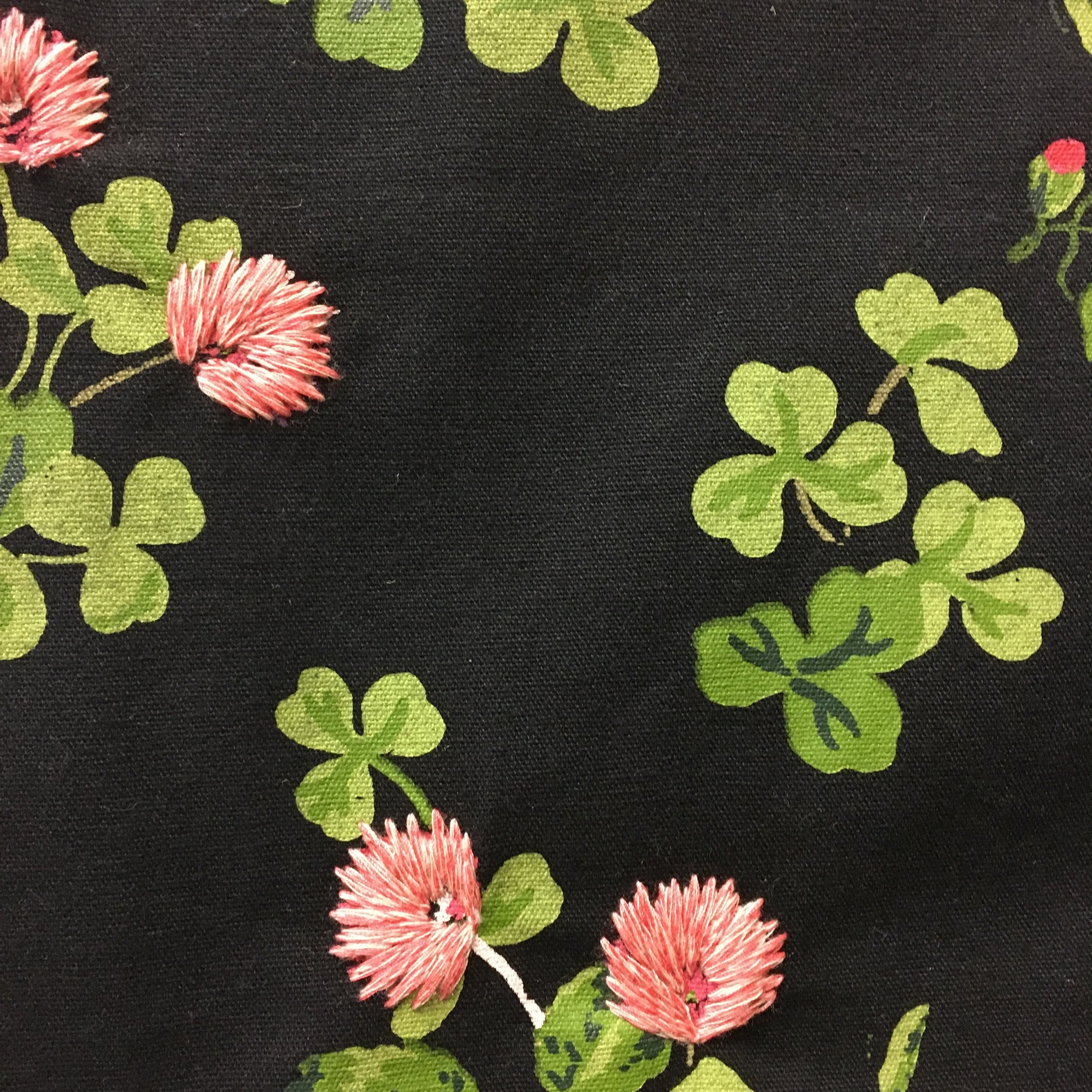 A dramatic black background makes this printed and embroidered floral pop