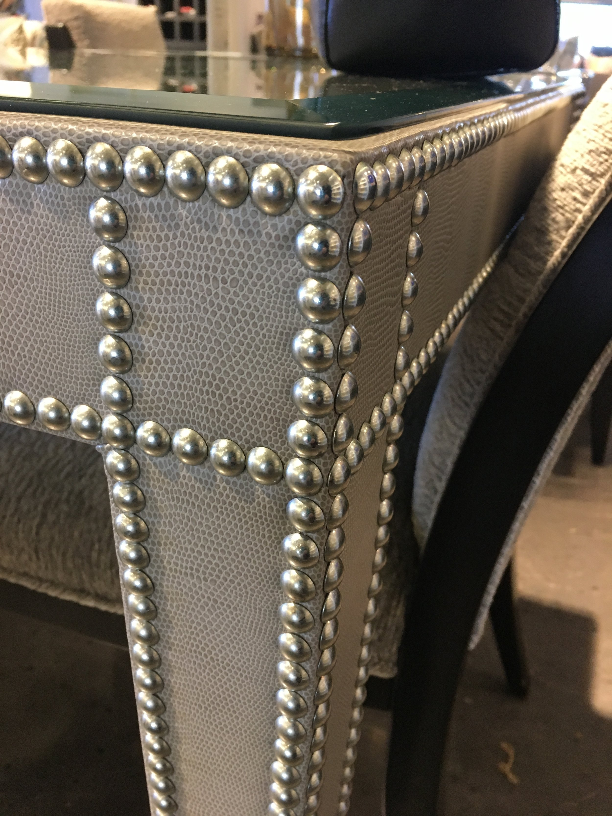 Choose your fabric or leather material and your nailhead color to customize this game table