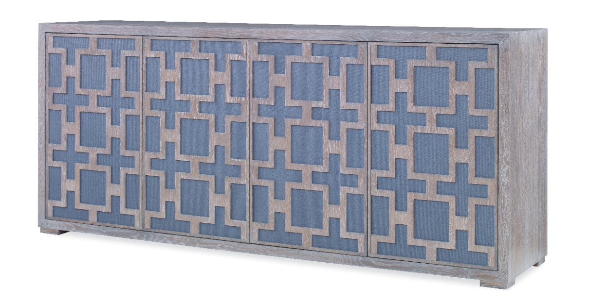Grasscloth backs the fretwork detailing on the front of this cerused oak sideboard
