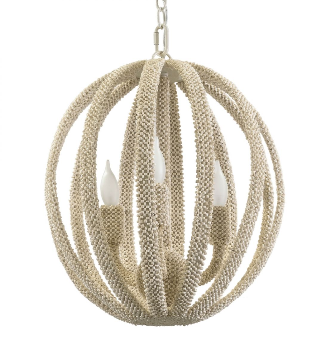 This globe chandelier is wrapped entirely in tiny white coco beads - perfect for a boho vibe!